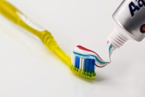 toothpaste going on toothbrush