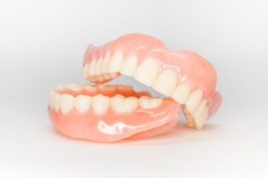 complete dentures in Orange Park against neutral background