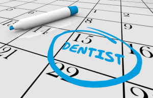 Calendar with reminder to visit Orange Park dentist for dental checkup