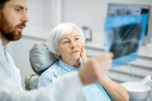 Older woman learning about gum disease and Alzheimer's disease